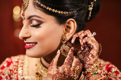 Lovely Indian  bride getting her earings on.