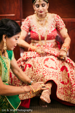 Maharani getting her anklet on.