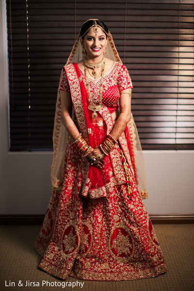 Sweet indian bride getting photo.