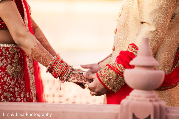 Indian couple holding hands closeup capture.