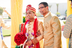 Charming Indian groom entrance to ceremony.