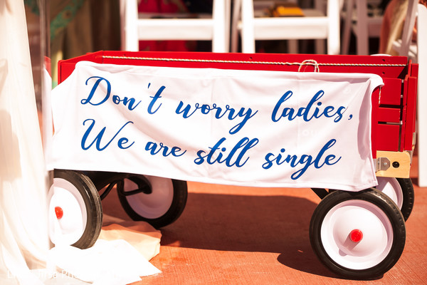 See this special Indian groomsmen sign.