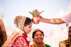 Sweet shot of bride during wedding ritual.