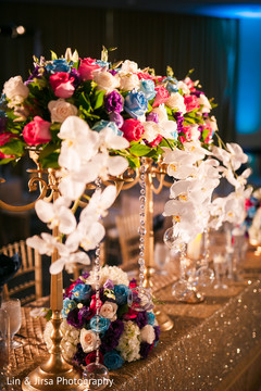Incredible Indian wedding roses table decoration.