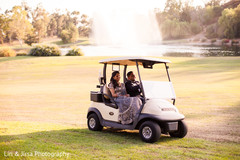 Sweet couple in a golf car.