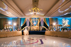 Incredible Indian wedding reception dance floor and stage decor.