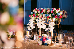Colorful Indian wedding reception table flowers decor.