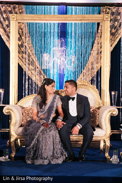 Enchanting indian couple at reception stage.
