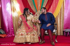 Raja and Maharani posing by the decor