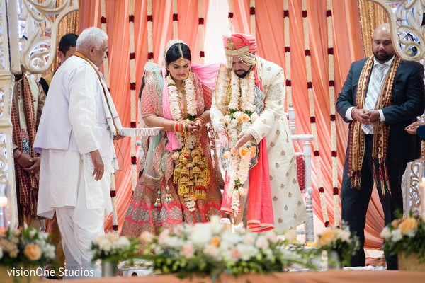 Indian bride and groom under the mandap