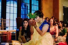Joyful Indian bride at her haldi celebration.