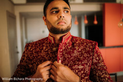 Closeup capture of Indian groom getting ready.