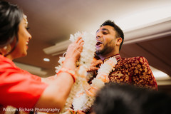 Joyful Indian groom's baraat celebration.