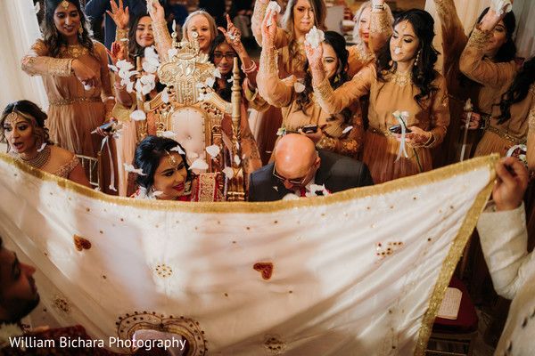 Lovely capture of Indian bridesmaids throwing petals to bride.