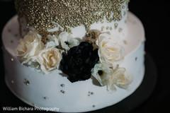 Stunning Indian wedding cake flowers decor.