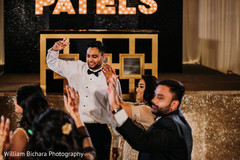 Indian bride and groom at reception dance capture.