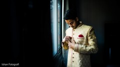 Indian groom getting his sherwani on.