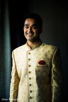 Cheerful Indian groom on his wedding ceremony outfit.