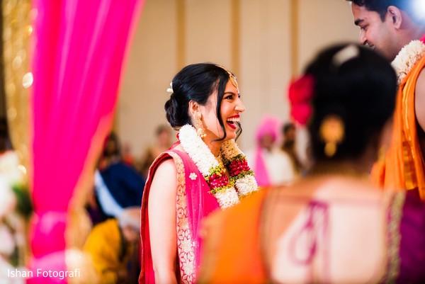 Sweet indian bride at her wedding varmala ritual.
