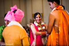 Indian bride and groom holding hands capture.