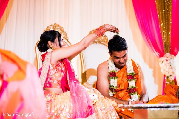 Indian wedding ceremony ritual showering of rice.