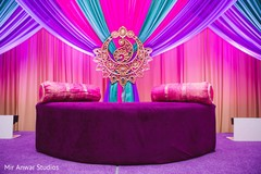 Colorful sangeet stage draping decorations.