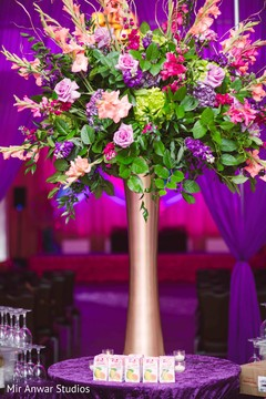 Colorful Indian sangeet table decor.