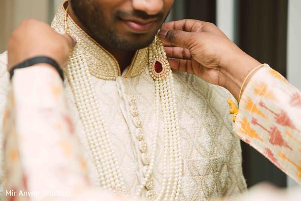 Indian groom putting his  kundan mala .