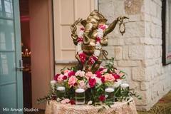 Graceful Indian wedding Ganesha Puja entrance decor.