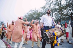 See this Dholi player at the baraat celebration.