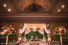 Incredible Indian wedding ceremony flowers and lights decor.
