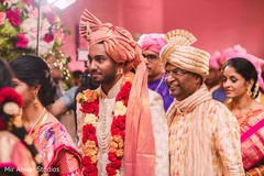 Charming Indian groom entering to his ceremony capture.