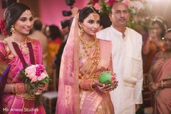 Enchanting Indian bride holding the ceremony coconut.