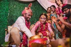 Indian couple at the pot ritual.