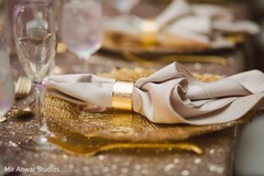 Golden Indian wedding reception table setup.