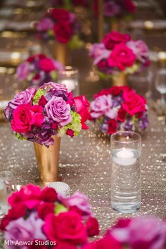 Lovely Indian wedding table flowers decor.