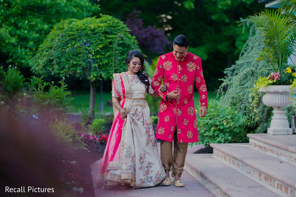 Indian couple walking out doors photo.