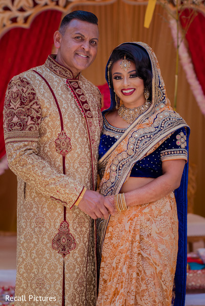 Stunning Indian bride posing with parent.