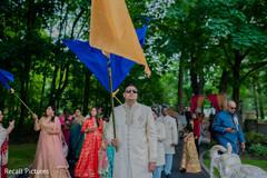 Joyful Indian groom's baraat procession.