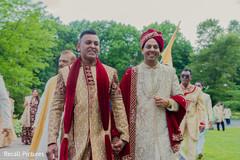 Indian groom walking at his baraat procession.