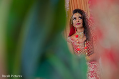 See this lovely Indian bride at her ceremony.