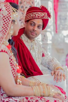 Charming groom looking at bride photo.