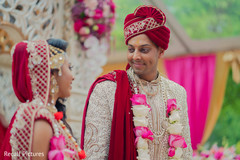 Gorgeous Indian bride and groom looking at each other.