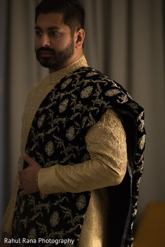 Elegant Indian groom posing for pictures