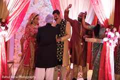 Indian groom being greeted by family
