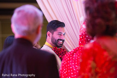 Indian groom smiling during the ceremony