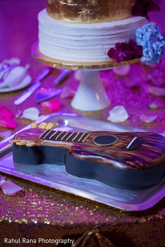 Guitar shaped cake ready for reception