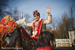Elegant Indian groom during the Baraat celebration.