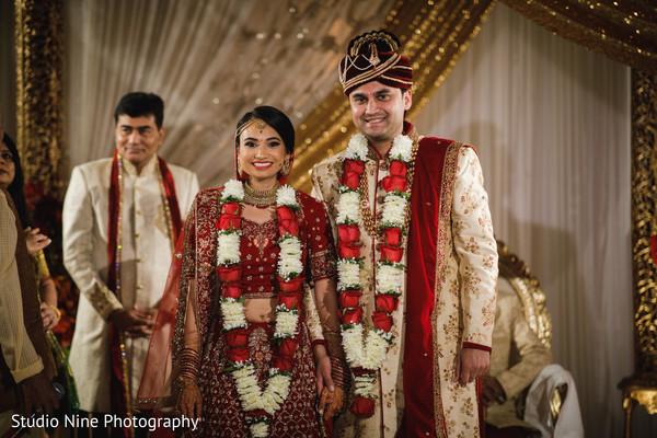 Traditional Indian bride and groom's jaimala ritual.