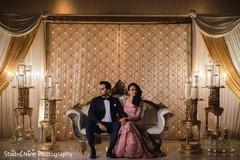 Elegant Indian couple posing for their photo shoot.